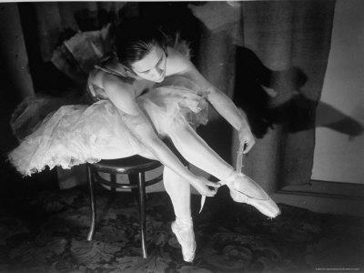 Premier Ballerina Semionova Tying Her Toe Shoe Before a Performance at the Great Theater - Premium Photographic Print