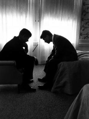 Jack Kennedy Conferring with His Brother and Campaign Organizer Bobby Kennedy in Hotel Suite - Photographic Print
