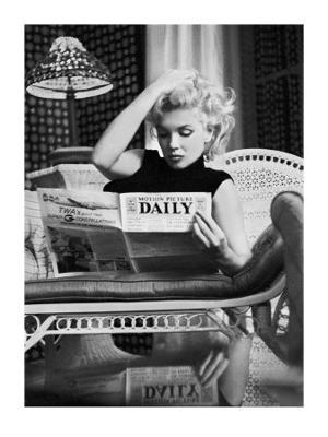 Marilyn Monroe Reading Motion Picture Daily, New York, c.1955 - Art Print