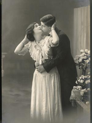 Two Lovers Embrace and Kiss - Photographic Print