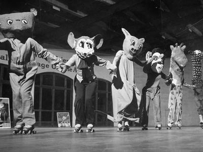 Roller Skaters in Costumes Performing on Stage at National Music Camp During Roller Skating Show - Premium Photographic Print