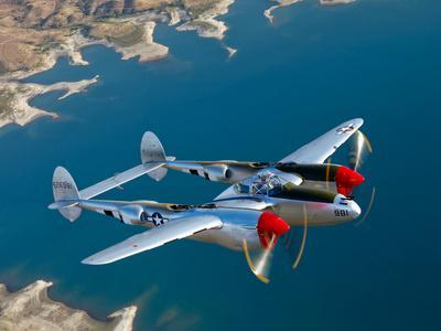 A Lockheed P-38 Lightning Fighter Aircraft in Flight - Photographic Print