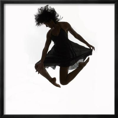 Woman Jumping in the Air Dancing - Framed Photographic Print