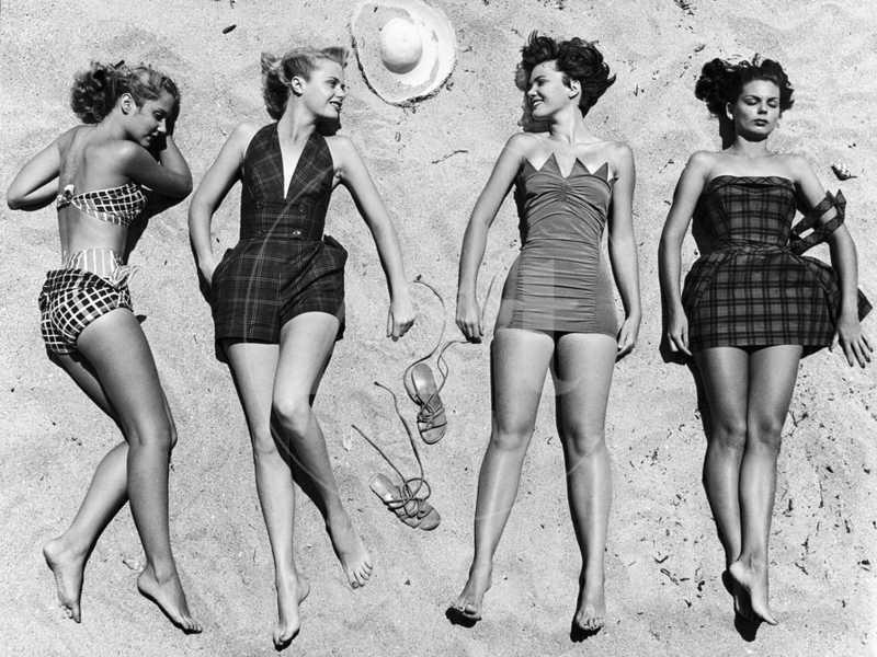 Models Sunbathing, Wearing Latest Beach Fashions
