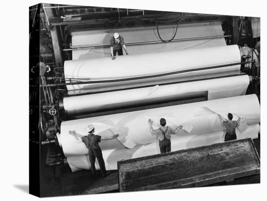 20 Ft. Roll of Finished Paper Arriving on the Rewinder, Ready to Be Cut and Shipped from Paper Mill-Margaret Bourke-White-Stretched Canvas Print