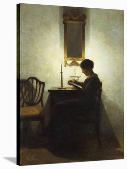A Woman Reading by Candlelight in an Interior-Peter Ilsted-Stretched Canvas Print
