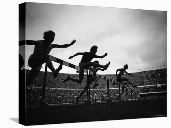 Action During the Women's 100m Hurdles at the 1952 Olympic Games in Helsinki-Mark Kauffman-Stretched Canvas Print