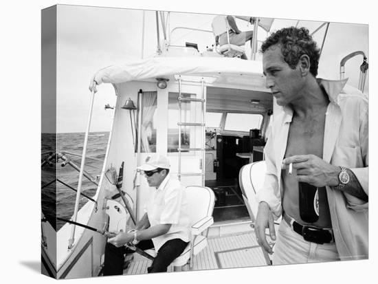 Actor Paul Newman Fishing with a Friend-Mark Kauffman-Stretched Canvas Print