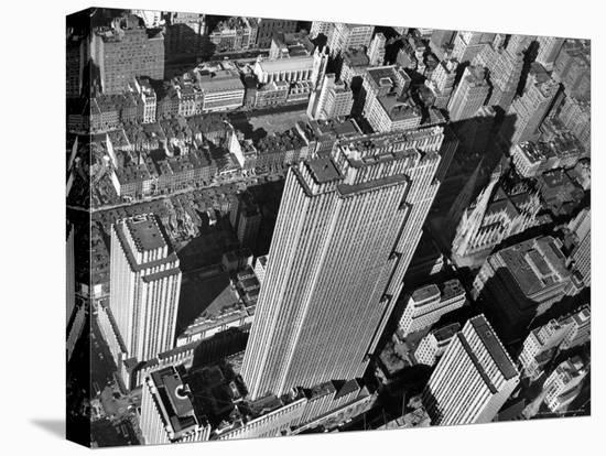 Aerial View Looking Down on 6th Ave. and 50th St. at Towering Rockefeller Center Complex-Margaret Bourke-White-Stretched Canvas Print