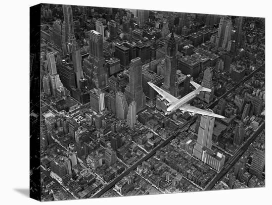 Aerial View of a Dc-4 Passenger Plane in Flight over Manhattan-Margaret Bourke-White-Stretched Canvas Print