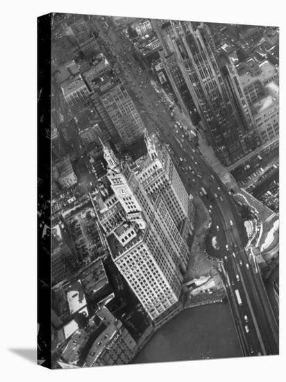 Aerial View of Buildings and a Bridge Crossing a River Flowing Through the City-Margaret Bourke-White-Stretched Canvas Print