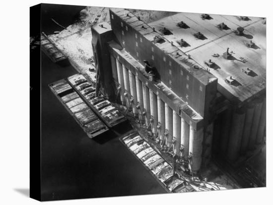 Aerial View of Cargill Grain Elevator with Barges Lined up on the Bank of the Chicago River-Margaret Bourke-White-Stretched Canvas Print