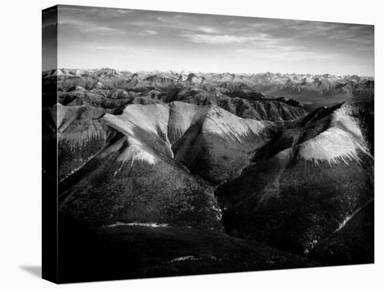 Aerial View of Snow-Capped Mountain Range in the Wenner-Gren Land Development Area-Margaret Bourke-White-Stretched Canvas Print