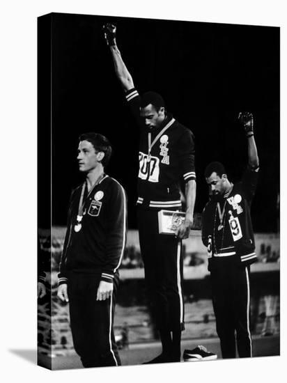 African American Track Star Tommie Smith, John Carlos After Winning Gold and Bronze Olympic Medal-John Dominis-Stretched Canvas Print
