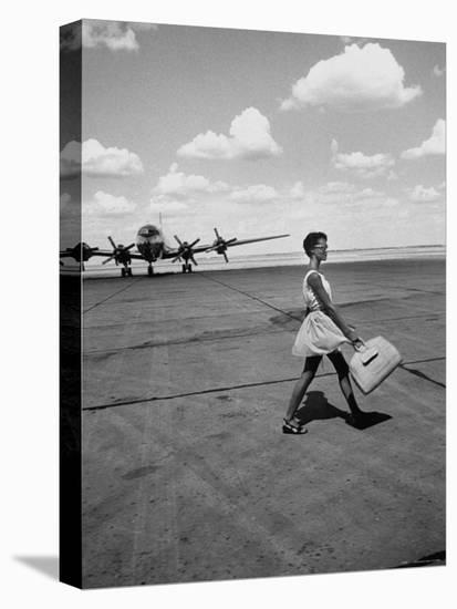 American Airline Hostess Crossing Field on Way to Jobs as a Model and Sales Clerk at Neiman Marcus-Lisa Larsen-Stretched Canvas Print