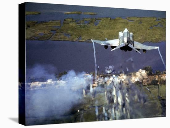 American F-4C Phantom Jet Streaming Contrails After Bombing Viet Cong Stronghold During Vietnam War-Larry Burrows-Stretched Canvas Print