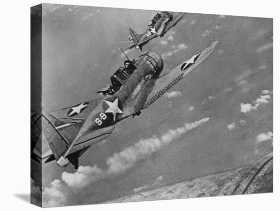 American Navy Torpedo Bombers Fly over Burning Japanese Ship During the Battle of Midway--Stretched Canvas Print