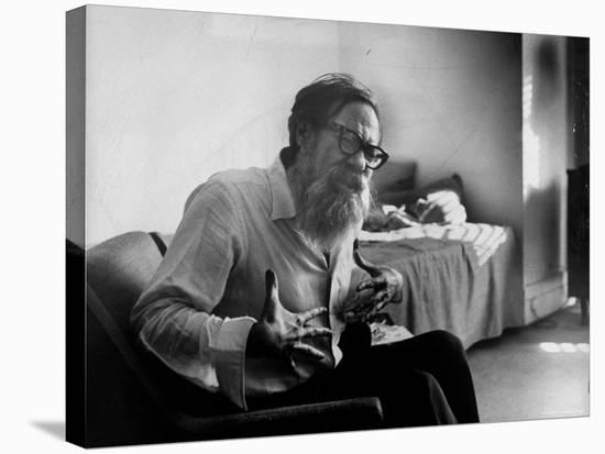 American Poet John Berryman Expressing Himself While Sitting in His Semi Empty Apartment-Mark Kauffman-Stretched Canvas Print