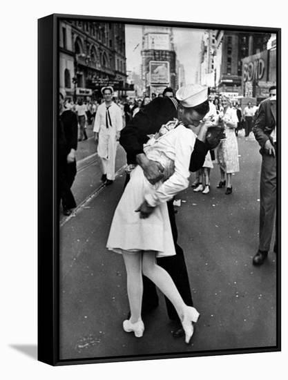 American Sailor Clutching a White-Uniformed Nurse in a Passionate Kiss in Times Square-Alfred Eisenstaedt-Framed Canvas Print