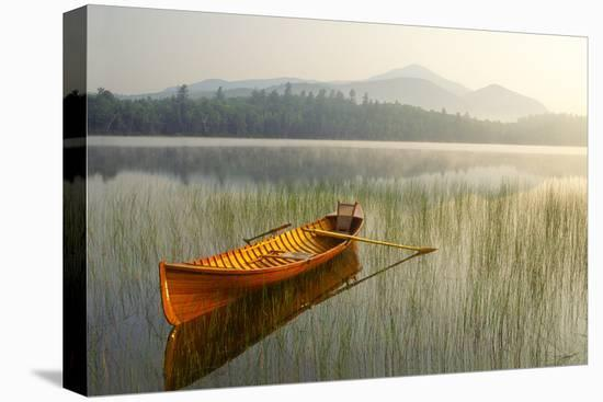 An Adirondack Guide Boat in a Calm Lake with Whiteface Mountain in the Background-Michael Forsberg-Stretched Canvas Print