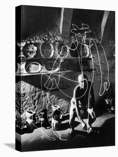 """Artist Pablo Picasso """"Painting"""" with Light at the Madoura Pottery--Stretched Canvas Print"""