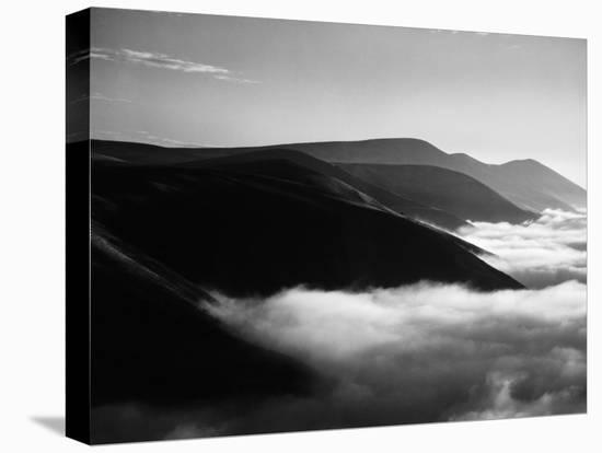 Banks of Fog Enveloping Mountains Outside San Francisco-Margaret Bourke-White-Stretched Canvas Print