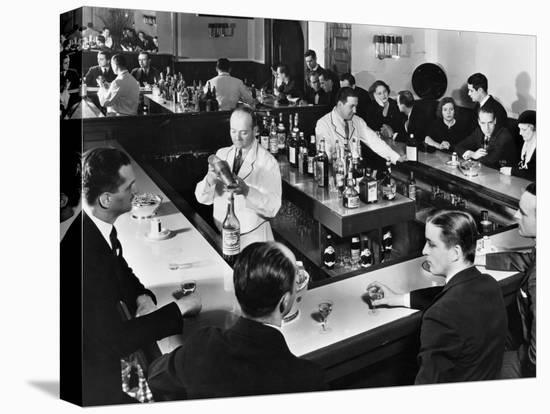 Bartender Prepares a Drink as Patrons Enjoy Themselves at Popular Speakeasy during Prohibition-Margaret Bourke-White-Stretched Canvas Print