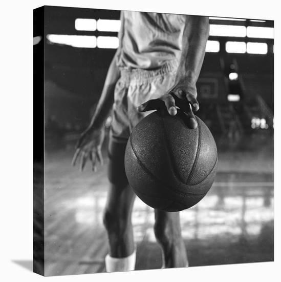 Basketball Held by Player Wilt Chamberlain, 1956-Frank Scherschel-Stretched Canvas Print