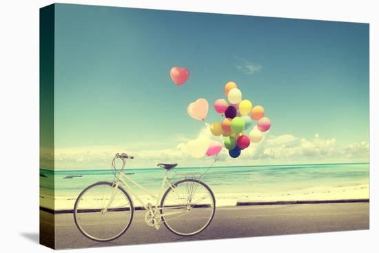 Bicycle Vintage with Heart Balloon on Beach Blue Sky Concept of Love in Summer and Wedding-jakkapan-Stretched Canvas Print