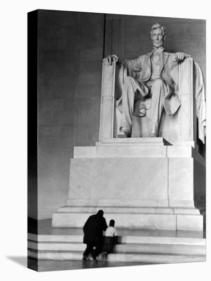 Black Man and Small Boy Kneeling Prayerfully on Steps on Front of Statue in the Lincoln Memorial-Thomas D. Mcavoy-Stretched Canvas Print