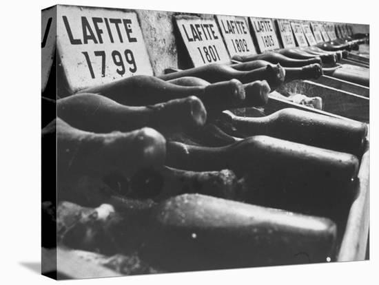 Bottles of Lafite Wines, Now Museum Pieces in French Wine Cellar-Carlo Bavagnoli-Stretched Canvas Print