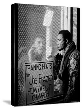 Boxer Muhammad Ali Taunting Rival Joe Frazier at Frazier's Training Headquarters-John Shearer-Premier Image Canvas