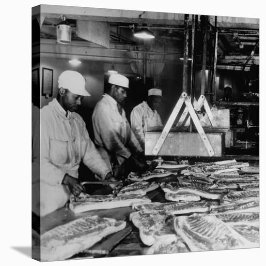 Butchers Trimming Pork Bellies for Bacon at Swift Meat Packing Packington Plant-Margaret Bourke-White-Stretched Canvas Print