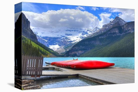 Canoes On Lake Louise Banff AB--Stretched Canvas Print