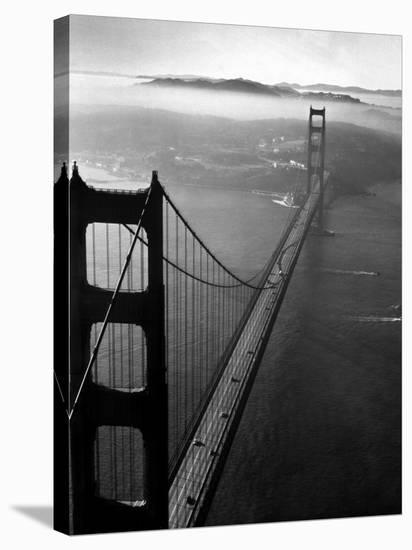 Car Lanes across the Golden Gate Bridge with Fog-Covered City of San Francisco in Background-Margaret Bourke-White-Stretched Canvas Print