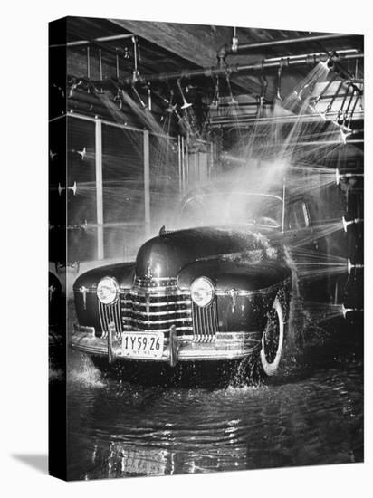 Car Rolling Through the Car Wash at Rockefeller Center-Bernard Hoffman-Stretched Canvas Print