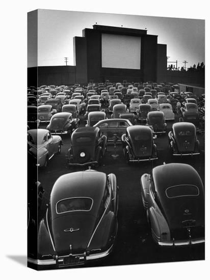 Cars Filling Lot at New Rancho Drive in Theater at Dusk Before the Start of the Feature Movie-Allan Grant-Stretched Canvas Print