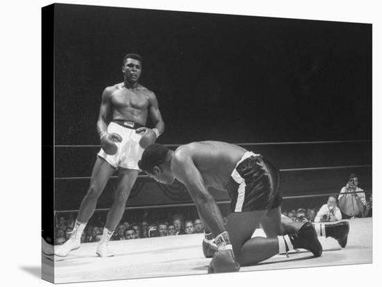 Cassius Clay Dancing Around Ring, Looking at Floyd Patterson, Whom He Has Just Knocked Down-Art Rickerby-Stretched Canvas Print