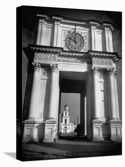 Cement Archway Featuring a Clock over the Entrance to the Grounds of the Greek Orthodox Church-Margaret Bourke-White-Stretched Canvas Print