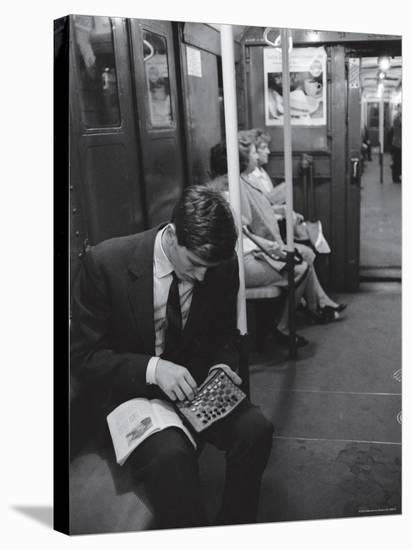 Chess Champion Bobby Fischer Working on His Moves During a Subway Ride-Carl Mydans-Stretched Canvas Print