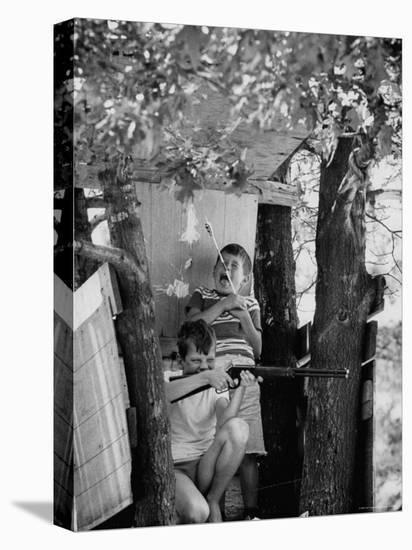Children Playing in a Treehouse-Arthur Schatz-Stretched Canvas Print