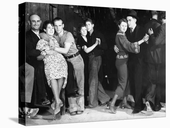 Construction Workers and Taxi Dancers Enjoying a Night Out in Barroom in Frontier Town-Margaret Bourke-White-Stretched Canvas Print