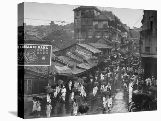 Crowds under Umbrellas on Street Outside Bombay Cotton Exchange During Monsoon Season-Margaret Bourke-White-Stretched Canvas Print