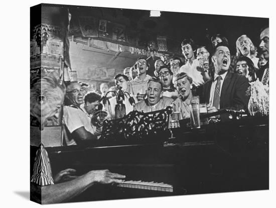 Customers at Bar of Casey's Limestone House Join in Singing Old Songs-Yale Joel-Stretched Canvas Print
