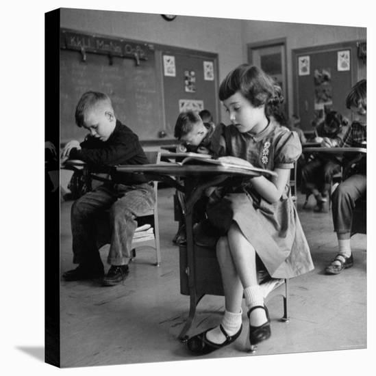 Cute Little Girl Busily at Work, Sitting in a Desk Chair in a Schoolroom, Other Pupils at Work Too-Gordon Parks-Stretched Canvas Print