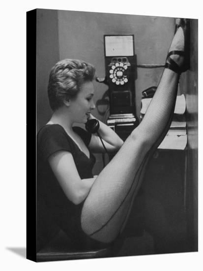 Dancer Mary Ellen Terry Talking with Her Legs Up in Telephone Booth-Gordon Parks-Stretched Canvas Print