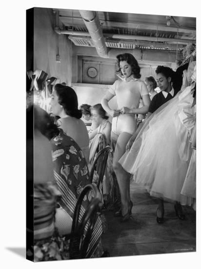 Debutante Actress Tina L. Meyer Changing Clothes Backstage in Dressing Room-Nina Leen-Premier Image Canvas