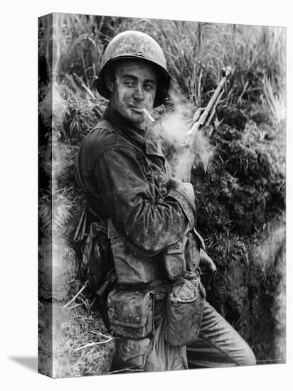 Dirt Smeared American Marine Terry Moore Soldier Stopping for a Cigarette Break-Carl Mydans-Stretched Canvas Print