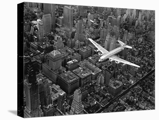 Douglas 4 Flying over Manhattan-Margaret Bourke-White-Stretched Canvas Print