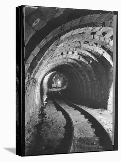 Electric Locomotive on Track in Powderly Anthracite Coal Mine Gangway, Owned by Hudson Coal Co-Margaret Bourke-White-Stretched Canvas Print